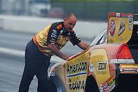 Nov. 10, 2011; Pomona, CA, USA; NHRA crew member for funny car driver Tony Pedregon during qualifying at the Auto Club Finals at Auto Club Raceway at Pomona. Mandatory Credit: Mark J. Rebilas-.