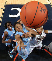 CHARLOTTESVILLE, VA- JANUARY 5: Tierra Ruffin-Pratt #44 of the North Carolina Tar Heels shoots in front of Ariana Moorer #15 of the Virginia Cavaliers during the game on January 5, 2012 at the John Paul Jones arena in Charlottesville, Virginia. North Carolina defeated Virginia 78-73. (Photo by Andrew Shurtleff/Getty Images) *** Local Caption *** Ariana Moorer;Tierra Ruffin-Pratt