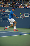 Roger Federer (SUI) struggles against Tommy Robredo (ESP) at the US Open being played at USTA Billie Jean King National Tennis Center in Flushing, NY on September 2, 2013