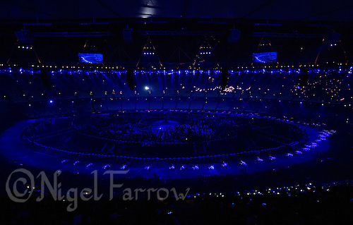 """27 JUL 2012 - LONDON, GBR - Performers dressed as doves, to represent the Doves of Peace, cycle around the arena on bikes during the """"Bike a.m."""" section of the Opening Ceremony of the London 2012 Olympic Games in the Olympic Stadium in the Olympic Park, Stratford, London, Great Britain (PHOTO (C) 2012 NIGEL FARROW)"""
