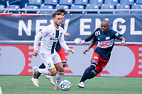 FOXBOROUGH, MA - JULY 4: Maxwell Hemmings #5 of Greenville Triumph SC brings the ball forward during a game between Greenville Triumph SC and New England Revolution II at Gillette Stadium on July 4, 2021 in Foxborough, Massachusetts.