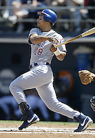 Moises Alou of the Chicago Cubs bats during a 2002 MLB season game against the San Diego Padres at Qualcomm Stadium, in San Diego, California. (Larry Goren/Four Seam Images)