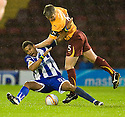 :: MOTHERWELL'S STEPHEN CRAIGAN  GETS THE BETTER OF WILLY AUBAMEYANG ::.11/05/2011 sct_jsp017_motherwell_v_kilmarnock     .Copyright  Pic : James Stewart.James Stewart Photography 19 Carronlea Drive, Falkirk. FK2 8DN      Vat Reg No. 607 6932 25.Telephone      : +44 (0)1324 570291 .Mobile              : +44 (0)7721 416997.E-mail  :  jim@jspa.co.uk.If you require further information then contact Jim Stewart on any of the numbers above.........