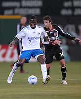 Kansas City Wizards forward Eddie Johnson holds the ball while defended by DC United midfielder Ben Olsen (14). The Kansas City Wizards defeated DC United 4-2, in the home opening game for DC United at RFK Stadium, April 14, 2007.