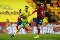 6th April 2021; Carrow Road, Norwich, Norfolk, England, English Football League Championship Football, Norwich versus Huddersfield Town; Jordan Hugill of Norwich City competes for the ball with Richard Keogh of Huddersfield Town