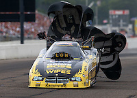 Aug 16, 2014; Brainerd, MN, USA; NHRA funny car driver Jeff Arend during qualifying for the Lucas Oil Nationals at Brainerd International Raceway. Mandatory Credit: Mark J. Rebilas-