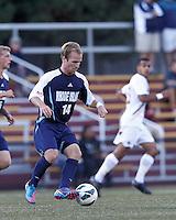 University of Rhode Island (URI) midfielder Brett Uttley (14) at midfield. Boston College defeated University of Rhode Island, 4-2, at Newton Campus Field, September 25, 2012.