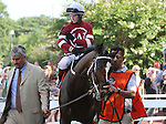 July 27, 2014: Untapable, Rosie Napravnik up, walks in the paddock before the Haskell. She is trained by Steve Asmussen, left.  Bayern, Martin Garcia up, wins the Haskell Invitational at Monmouth Park in Oceanport, NJ.  Trainer is Bob Baffert; owner is Kaleem Shah, Inc. ©Joan Fairman Kanes/ESW/CSM