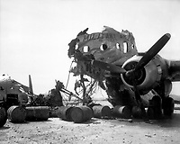 Wreckage of big transport which North Koreans hit while it was on Kimpo Airfield, is again in friendly hands, upon recapture of field.  September 18, 1950.  Sgt. Frank C. Kerr. (Marine Corps)<br /> NARA FILE #:  127-N-A2812<br /> WAR & CONFLICT BOOK #:  1500