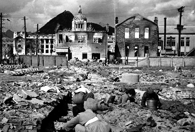 Korean women and children search the rubble of Seoul for anything that can be used or burned as fuel.  November 1, 1950.  Capt. F. L. Scheiber. (Army)<br /> NARA FILE #:  111-SC-351697<br /> WAR & CONFLICT BOOK #:  1503