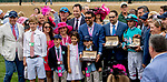 LOUISVILLE, KY - MAY 04: Connections to Monomoy Girl pose while holding Longines watches after Monomoy Girls wins the Kentucky Oaks at Churchill Downs on May 4, 2018 in Louisville, Kentucky. (Photo by Sue Kawczynski/Eclipse Sportswire/Getty Images)