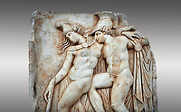 Roman Sebasteion relief sculpture of Achilles and a dying Amazon, Aphrodisias Museum, Aphrodisias, Turkey.   <br /> <br /> Achilles supports the dying Amazon queen Penthesilea whom he has mortally wounded. Her double headed axe slips from her hands. The queen had come to fight against the Greeks in the Trojan war and Achilles fell in love with her.