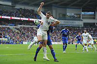 Sean Morrison of Cardiff City vies for possession with Sam Vokes of Burnley during the Premier League match between Cardiff City and Burnley at Cardiff City Stadium in Cardiff, Wales, UK. Sunday 30 September 2018