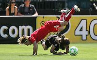 Sonia Bompastor falls over Tina DiMartino. FC Gold Pride defeated Washington Freedom 3-2 at Buck Shaw Stadium in Santa Clara, California on August 1, 2009.