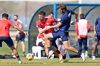 BRADENTON, FL - JANUARY 23: Tristan Blackmon, Tanner Tessmann battle for a ball during a training session at IMG Academy on January 23, 2021 in Bradenton, Florida.