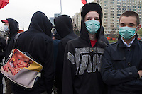Moscow, Russia, 01/05/2011..Masked young anarchists as a mixture of Communist and anarchist anti-government groups demonstrate in central Moscow. A variety of political groups took to the streets on the traditional Russian Mayday holiday.