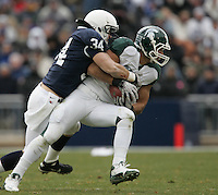 State College, PA - 11/27/2010:  LB Nate Stupar (34) tackles the Michigan State receiver.  Stupar had 10 tackles during the game.  Penn State lost to Michigan State by a score of 28-22 on Senior Day at Beaver Stadium...Photo:  Joe Rokita / JoeRokita.com..Photo ©2010 Joe Rokita Photography
