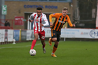 Remeao Hutton of Stevenage evades James Scott of Hull City during Stevenage vs Hull City, Emirates FA Cup Football at the Lamex Stadium on 29th November 2020