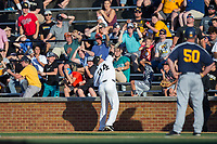 Wake Forest Demon Deacons first baseman Gavin Sheets (24) reaches into the stands to catch a foul pop fly during the game against the West Virginia Mountaineers in Game Four of the Winston-Salem Regional in the 2017 College World Series at David F. Couch Ballpark on June 3, 2017 in Winston-Salem, North Carolina.  The Demon Deacons walked-off the Mountaineers 4-3.  (Brian Westerholt/Four Seam Images)