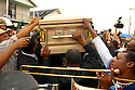 Mourners carry the casket of Dinerral Shavers, 25, who died from a gunshot to the back of his head in New Orleans, Sat., Jan. 6, 2007. Shavers was the snare drummer for the Hot 8 Brass Band and the music teacher at L.E. Rabouin High School, where he had recently begun the school's first-ever marching band. He was killed by a teen who was trying to shoot his stepson. ..(AP Photo/Cheryl Gerber).