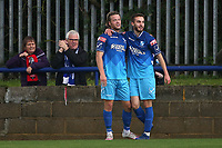 Kavan Cotter of Wingate & Finchley (L) scores the second goal for his team and celebrates with his team mates during Wingate & Finchley vs Lewes, Pitching In Isthmian League Premier Division Football at the Maurice Rebak Stadium on 3rd October 2020