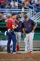 State College Spikes left fielder Andres Luna (4) gets looked at by trainer Joey Olsiewicz and manager Joe Kruzel (13) after getting hit by a pitch during a game against the Batavia Muckdogs on July 7, 2018 at Dwyer Stadium in Batavia, New York.  State College defeated Batavia 7-4.  (Mike Janes/Four Seam Images)
