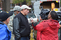 October 30, 2012  (Washington, DC) Mayor Vincent Gray speaks with the news media on Evarts St. NE while touring Hurricane Sandy storm damage. Major General Errol Schwartz  (background) looks on.  (Photo by Don Baxter/Media Images International)