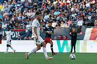 FOXBOROUGH, MA - JUNE 23: Sean Nealis #15 of New York Red Bulls passes the ball during a game between New York Red Bulls and New England Revolution at Gillette Stadium on June 23, 2021 in Foxborough, Massachusetts.