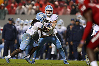 RALEIGH, NC - NOVEMBER 30: Sam Howell #7 of the University of North Carolina hands the ball to Michael Carter #8 during a game between North Carolina and North Carolina State at Carter-Finley Stadium on November 30, 2019 in Raleigh, North Carolina.