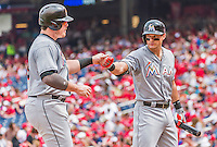 30 August 2015: Miami Marlins outfielder Derek Dietrich greets teammate Justin Bour at home after Bour hits a 3-run home run in the first inning against the Washington Nationals at Nationals Park in Washington, DC. The Nationals rallied to defeat the Marlins 7-4 in the third game of their 3-game weekend series. Mandatory Credit: Ed Wolfstein Photo *** RAW (NEF) Image File Available ***