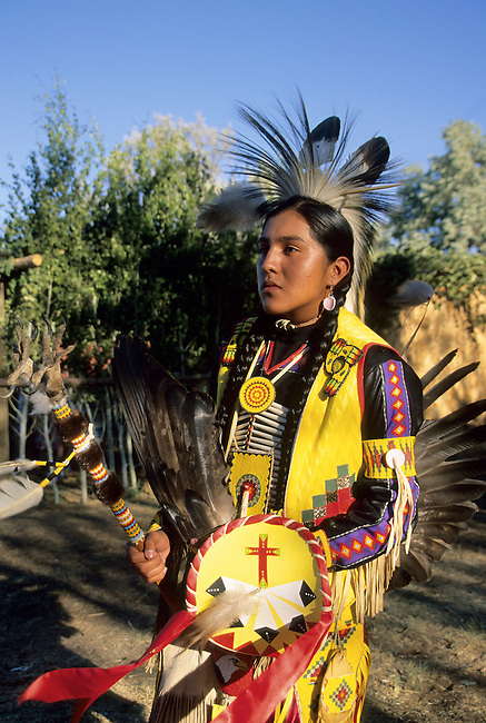Teenage boy dressed in a traditional pow wow yellow regalia on the Chippewa Cree Rocky Boy Reservation in Box Elder Montana