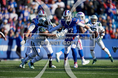 Buffalo Bills quarterback Josh Allen (17) stiff arms Leonard Williams (92) during an NFL football game against the New York Jets, Sunday, December 9, 2018, in Orchard Park, N.Y.  (Mike Janes Photography)
