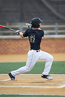 Stuart Fairchild (4) of the Wake Forest Demon Deacons follows through on his swing against the Clemson Tigers at David F. Couch Ballpark on March 12, 2016 in Winston-Salem, North Carolina.  The Tigers defeated the Demon Deacons 6-5.  (Brian Westerholt/Four Seam Images)