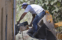 Pictured: A worker uses a cutting disc to cut through the walls of the building before a digger moves in to demolish part of the house where Ben Needham disappeared from in Kos, Greece. Tuesday 04 October 2016<br />Re: Police teams led by South Yorkshire Police, searching for missing toddler Ben Needham on the Greek island of Kos have moved to a new area in the field they are searching.<br />Ben, from Sheffield, was 21 months old when he disappeared on 24 July 1991 during a family holiday.<br />Digging has begun at a new site after a fresh line of inquiry suggested he could have been crushed by a digger.