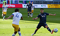 KANSAS CITY, KS - NOVEMBER 22: Oswaldo Alanis #4 of the San Jose Earthquakes passes the ball upfield as Roger Espinoza #15 of Sporting KC tries to block him before a game between San Jose Earthquakes and Sporting Kansas City at Children's Mercy Park on November 22, 2020 in Kansas City, Kansas.