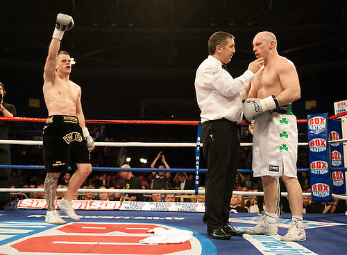 GLASGOW, SCOTLAND - MARCH 10: Tommy Tolan (white shorts) being counted out in his bout with Callum Johnson (black shorts) during their Light-Heavyweight contest on the Ricky Burns undercard at the Braehead Arena on March 10, 2012 in Glasgow, Scotland. (Photo by Rob Casey/Getty Images)