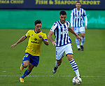 Mikel Merino (Real Sociedad)  and Iza Carcelén (Cadiz CF)competes for the ball during  La Liga match round 10 between Cadiz CF and Real Sociedad at Ramon of Carranza Stadium in Cadiz, Spain, as the season resumed following a three-month absence due to the novel coronavirus COVID-19 pandemic. Nov 22, 2020. (ALTERPHOTOS/Manu R.B.)