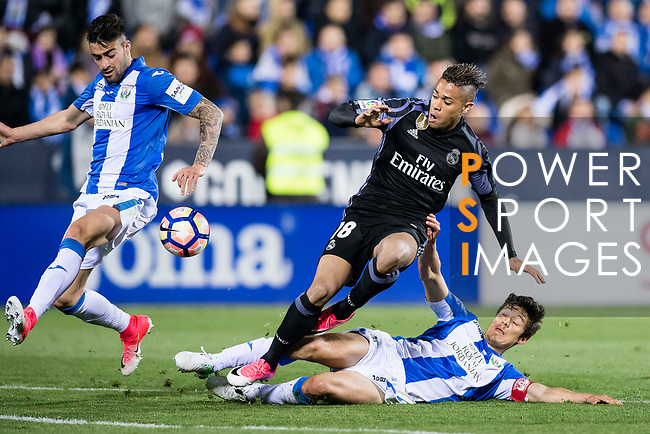 Mariano Diaz Mejia (c) of Real Madrid battles for the ball with Diego Rico (l) and Martin Mantovani of Deportivo Leganes during their La Liga match between Deportivo Leganes and Real Madrid at the Estadio Municipal Butarque on 05 April 2017 in Madrid, Spain. Photo by Diego Gonzalez Souto / Power Sport Images