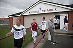 Whitehill Welfare 4 Gala Fairydean Rovers 2, 10/08/2013. Ferguson Park, Scottish Lowland Football League. Gala Fairydean Rovers players (in white) walking on to the pitch prior to their team's inaugural match in the Scottish Lowland Football League away to Whitehill Welfare at Ferguson Park. Gala were formed in 2013 by an a re-amalgamation of Gala Fairydean and Gala Rovers, the two clubs having separated in 1908 and Gala's Netherdale ground in Galashiels in the Scottish Borders had one of only two stands designated as listed football stands in Scotland. Whitehill won the match, the first-ever in the newly-formed Lowland League by 4 goals to 2. Photo by Colin McPherson.
