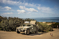 An autonomous Humvee is parked along a testing route at Spawar, or Space and Naval Warfare Systems Command, a research and operations arm of the Navy. The Unmanned Systems Group at Spawar is developing autonomous vehicles for the military, which they think will revolutionise the way the military fights. The challenge is to develop autonomous vehicles sturdy enough to operate in environments where there are no roads.