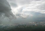 Looking at Herculanem from the top of Mount Vesuvius with menacing clouds framing the scene.