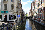 Coffeeshop along a <br /> canal in  Amsterdam, Netherlands