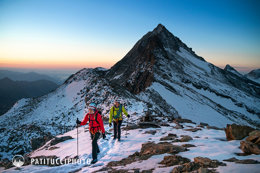 Climbers on their way to climb the Weissmies at sunrise, Switzerland