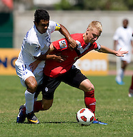Julio Moncada (9) of Honduras fights for the ball with Bryce Alderson (8) of Canada during the group stage of the CONCACAF Men's Under 17 Championship at Catherine Hall Stadium in Montego Bay, Jamaica. Canada tied Honduras, 0-0.