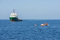 """Sea Watch-2.<br /> Die Sea Watch-2 bei ihrer 13. SAR-Mission vor der libyschen Kueste.<br /> Im Bild: Ein Schlauchboot mit ca. 160 Menschen wird von der Sea Watch-Crew mit Rettungswesten versorgt. Im Hintergrund die """"Bourbon Argus"""" der Hiflfsorganisation """"Aerzte ohne Grenzen"""". Die Bourbon Argus hat die Menschen im laufe des Tages aufgenommen.<br /> 20.10.2016, Mediterranean Sea<br /> Copyright: Christian-Ditsch.de<br /> [Inhaltsveraendernde Manipulation des Fotos nur nach ausdruecklicher Genehmigung des Fotografen. Vereinbarungen ueber Abtretung von Persoenlichkeitsrechten/Model Release der abgebildeten Person/Personen liegen nicht vor. NO MODEL RELEASE! Nur fuer Redaktionelle Zwecke. Don't publish without copyright Christian-Ditsch.de, Veroeffentlichung nur mit Fotografennennung, sowie gegen Honorar, MwSt. und Beleg. Konto: I N G - D i B a, IBAN DE58500105175400192269, BIC INGDDEFFXXX, Kontakt: post@christian-ditsch.de<br /> Bei der Bearbeitung der Dateiinformationen darf die Urheberkennzeichnung in den EXIF- und  IPTC-Daten nicht entfernt werden, diese sind in digitalen Medien nach §95c UrhG rechtlich geschuetzt. Der Urhebervermerk wird gemaess §13 UrhG verlangt.]"""