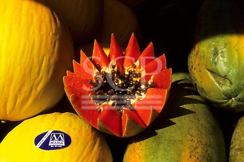 Brazil. Papaya - 'Mamao' (Carica papaya) cut open to show seeds and flesh, and melons.