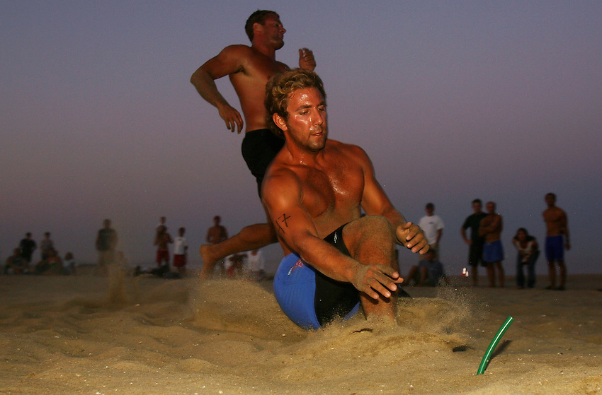 Joe Cucci of Bradley Beach grabs the final flag to win the Beach Flags event at the First Annual Asbury Park Beach Bar Lifeguard Competition held at the 3rd Avenue beach in Asbury Park. ASBURY PARK, NJ  8/4/07  8:21:47 PM  PHOTO BY ANDREW MILLS