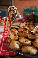 Detail of a plate of traditional Swedish Christmas bread and a straw decoration