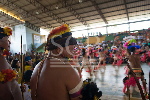 """Altamira, Brazil. """"Xingu Vivo Para Sempre"""" protest meeting about the proposed Belo Monte hydroeletric dam and other dams on the Xingu river and its tributaries. Indians watching the dancers from Medicilandia."""