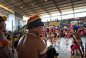 "Altamira, Brazil. ""Xingu Vivo Para Sempre"" protest meeting about the proposed Belo Monte hydroeletric dam and other dams on the Xingu river and its tributaries. Indians watching the dancers from Medicilandia."